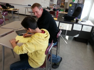 Rob Warneke helping a student after his Peer Instruction flipped class.