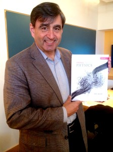 Eric Mazur with his new textbook, Principles and Practice of Physics.
